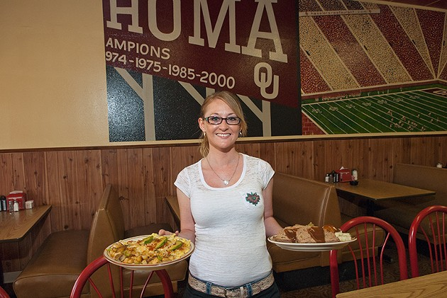 Waitress Heather Azbell with a California Omelette, left, and a Meat Loaf, Green Beans and Mashed Potatoes plate, at Hassler's Restaurant in Norman. - MARK HANCOCK