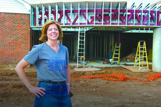 Katie Fitzgerald, executive director for Center for Children and Families stands near the entrance of their new construction site in Norman. Proceeds from Tour de Vin will benefit the non profit organization. Photo/Shannon Cornman - SHANNON CORNMAN
