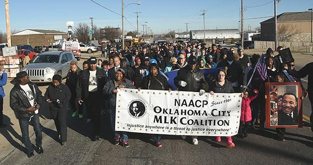 "The ""Silent March"" makes it's way from the Freedom Center, 2609 N. Martin Luther King Avenue, Monday morning, marking MLK Day on the way to the State Capitol.  mh"