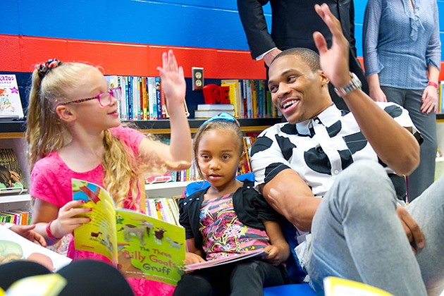 """Russell Westbrook stops into """"Russell's Reading Room"""" to read books with children at North Highland Elementary.Photo/Shannon Cornman - girls are Lillian left, and Ayana, right."""