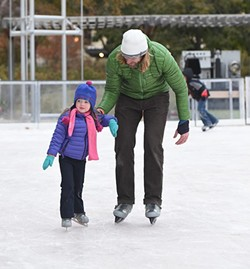 Students with their parants from the John W. Rex Downtown Elementary School, enjoy the Devon Ice Rink at the Myriad Botanical Gardens, 11-12-14.  mh