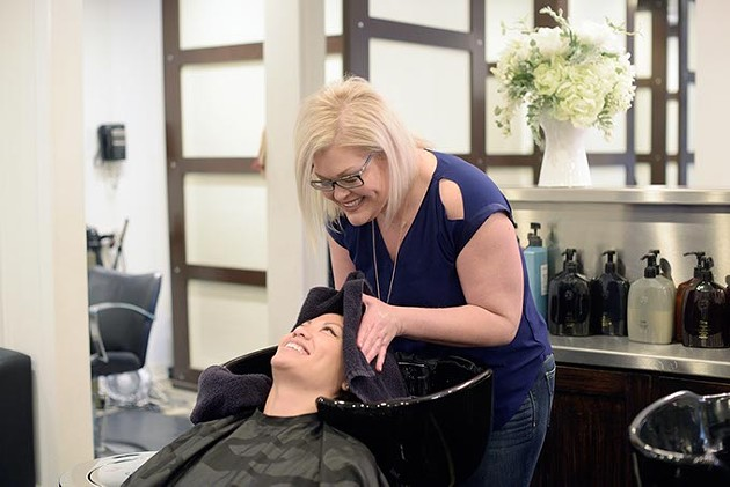 Malisa Osborne washes Theresa Pham hair at Van Cleefs Salon, Wednesday, Feb. 22, 2017. - GARETT FISBECK