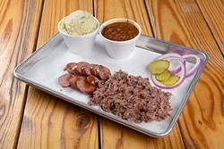 2 Meat dinner with Chopped Brisket, Plain Sausage, Beans and Potato Salad at Texlahoma BBQ in Edmond, Tuesday, Dec. 13, 2016. - GARETT FISBECK