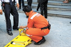 Bangkok Thailand - November 20 2015 : Many working people preparedness for fire drill or other disaster at office in Bangkok Thailand - BIGSTOCK