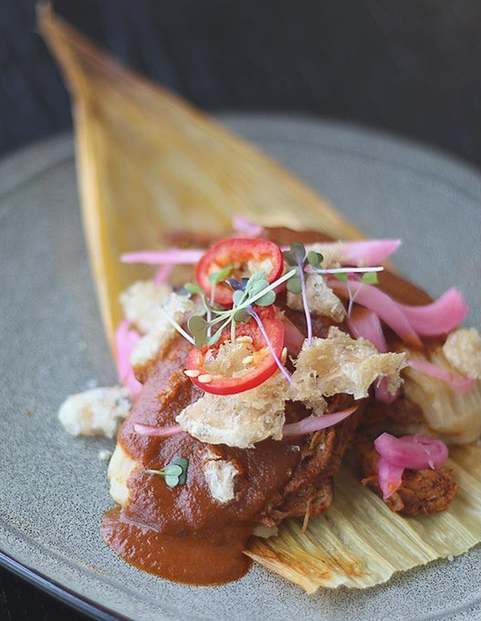 Red Chili Pork Tamale with mole manchemanteles and chicharrón at Barrios Fine Mexican Dishes. (Cara Johnson).