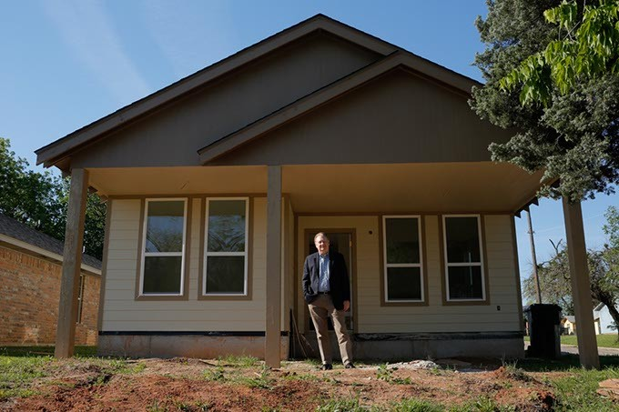 Roland J. Chupik, executive director of Neighborhood Housing Services Oklahoma, poses for a photo in front of one of his company's building projects, Friday, May 5, 2017. - GARETT FISBECK