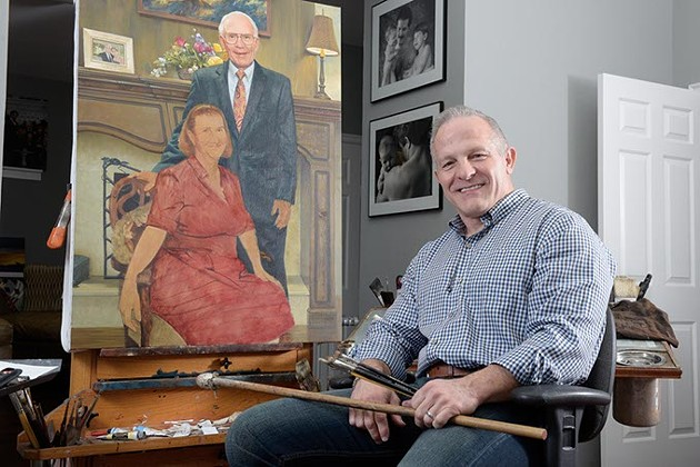 Artist Mike Wimmer poses for a photo at his home studio, Friday, Sept. 23, 2016. - GARETT FISBECK
