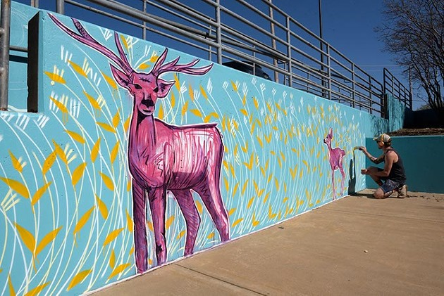 Jason Pawley works on a mural at Eugene Field Elementary, Monday, March 20, 2017. - GARETT FISBECK