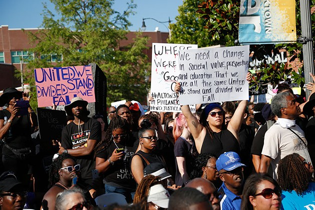 Supporters stand with signs during a Black Lives Matter demonstration in Oklahoma City, Sunday, July 10, 2016. - GARETT FISBECK