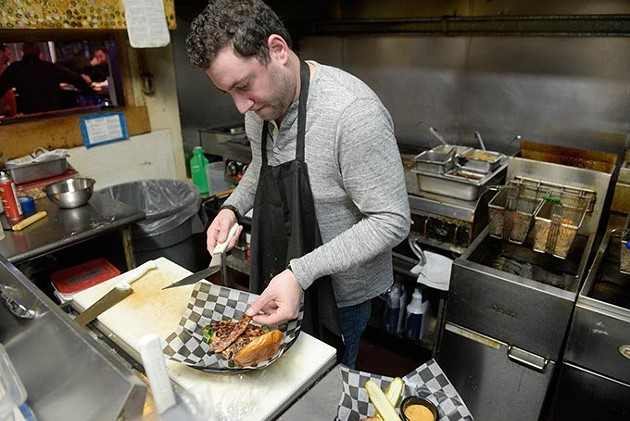 Ned Shadid works in the kitchen at Ned's Kitchen, Monday, Dec. 19, 2016. - GARETT FISBECK