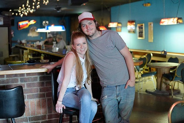 ?Michelle Simer and Tanner Miller pose for a photo at Blue Bonnet Bar, Friday, April 14, 2017. - GARETT FISBECK