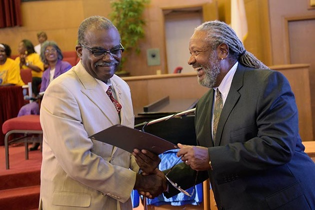 Larry Jeffries presented a citation of recognition to Booker Roberts, one of the NAACP Minute Men Commandos, during the 59th Oklahoma City Sit-In Anniversary at Fifth Street Baptist Church earlier this month. (Garett Fisbeck)