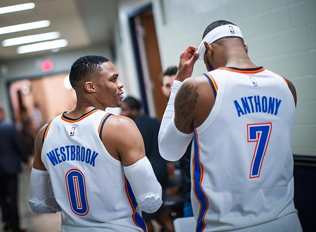 Russell Westbrook speaks with teammate Carmelo Anthony, who was acquired through a trade with the New York Knicks in September. (Zach Beeker / Oklahoma City Thunder / provided)