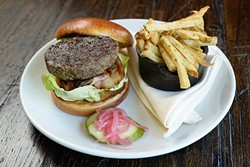 Bison burger with pork belly at Hutch on Avondale, Tuesday, May 2, 2017. - GARETT FISBECK