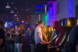 Zach Henthorn plays retro arcade games at the Flash Back Retro Pub 90's Night on Saturday, July 30, 2016 in Oklahoma City. - EMMY VERDIN