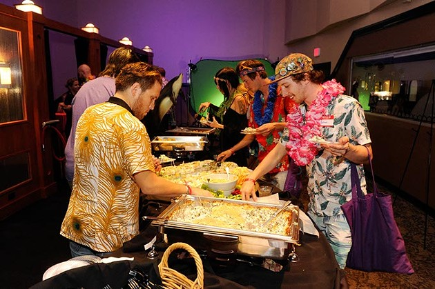 Best of OKC party guests mob the buffet at Will Rogers Theatre during the Aug. 23 appreciation event.