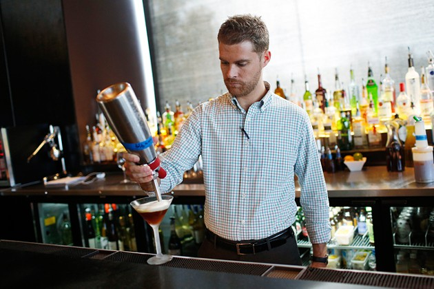 Ryan Young, bar manager, at Cafe 501 in Oklahoma City, Tuesday, Nov. 10, 2015. - GARETT FISBECK