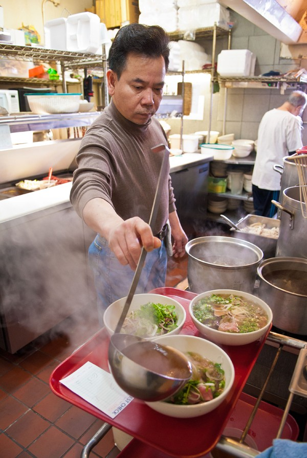 Duy Tran cooks everything from scratch in the kitchen at Pho Cuong.  mh