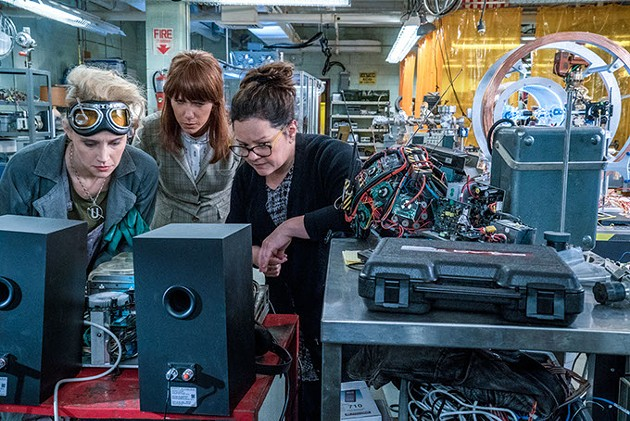 Erin (Kristen Wiig) comes to talk to Abby (Melissa McCarthy) and Holtzmann (Kate McKinnon) at the Paranormal Studies Lab at the Higgin's Institute in Columbia Pictures' GHOSTBUSTERS. - HOPPER STONE, SMPSP