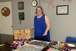 Cathy Sabin poses for a photo at The Craft Room, Tuesday, July 18, 2017. - GARETT FISBECK