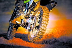 action of enduro motorcycle on dirt track - BIGSTOCK