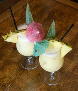 Two Piña Coladas at Rockford Cocktail Den (Garett Fisbeck)
