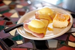 Eggs Benedict with cheese grits at Classen Grill in Oklahoma City, Friday, June 26, 2015. - GARETT FISBECK
