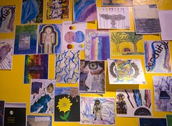 Teen Art is displayed on a wall at Teen Recovery Solutions in Oklahoma City, Wednesday, June 8, 2016.  (Emmy Verdin - EMMY VERDIN