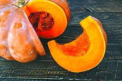 sliced pumpkin, pumpkin on the table, sliced pumpkin on the table. - BIGSTOCK