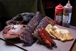 Ribs, brisket, hot links, and bologna, at Leo's BBQ, Monday, Dec. 5, 2016. - GARETT FISBECK