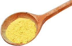 Nutritional yeast flakes in a wooden spoon isolated on white with clipping path included. - BIGSTOCK