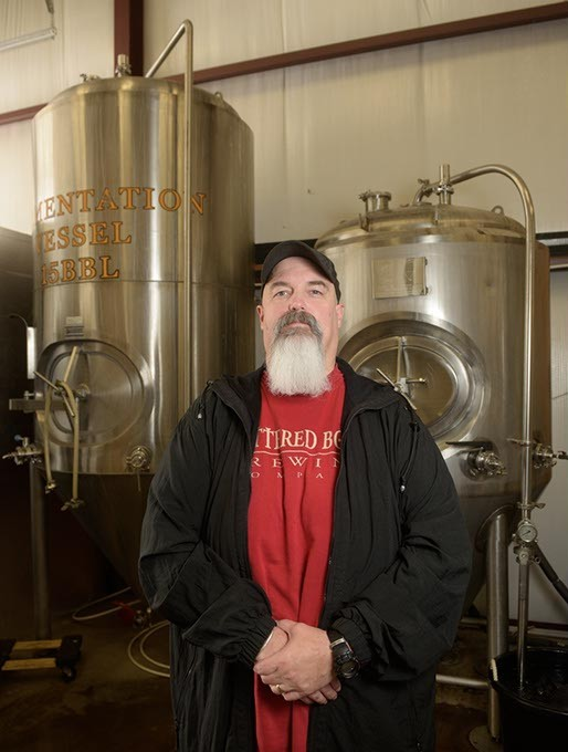 Mike Sandefur poses for a photo at Battered Boar Brewing Company, Monday, June 5, 2017. - GARETT FISBECK