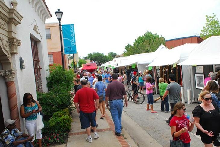 Guests browse the 2015 Paseo Arts Festival.   Photo Gazette / File