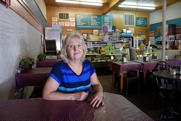 Peggy Carty poses for a photo at Someplace Else Deli, Monday, Sept. 19, 2016. - GARETT FISBECK