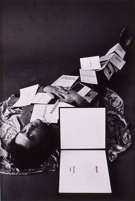 """""""Ed Ruscha Covered with Twelve of his Books"""" by Jerry McMillan (Image Fred Jones Jr. Museum of Art / provided)"""