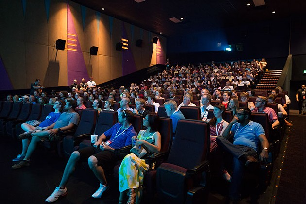 Audience members listen to an introduction of Comedy Shorts at the Dead Center Film in Oklahoma City, Saturday, June 11, 2016. - EMMY VERDIN