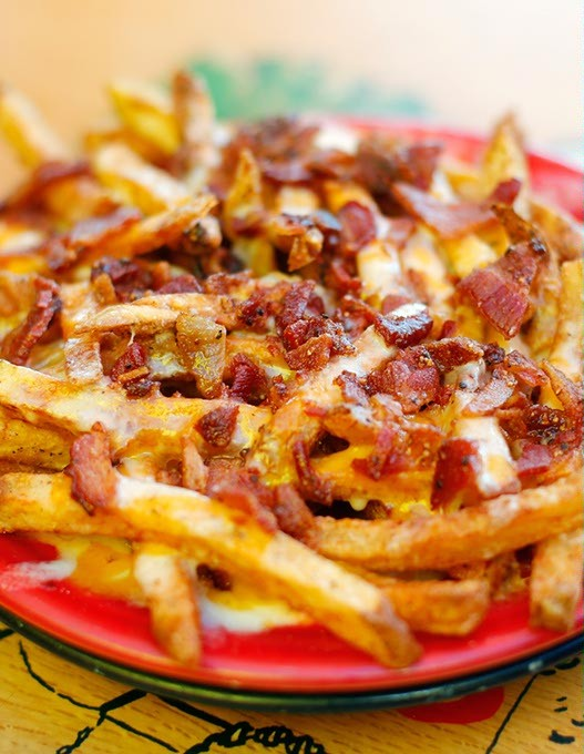 Bacon cheese fries at Eskimo Joe's in Stillwater, Thursday, Aug. 6, 2015. - GARETT FISBECK
