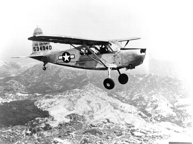 Single Vultee USAF L-5 shown in flight. This aircraft is powered by an O-series engine. - PHOTO COURTESY OF THE TINKER HISTORY OFFICE
