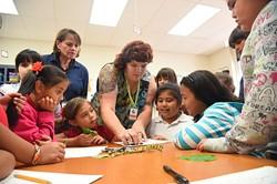 Left to right, teachers Kathleen Blake and Kristina Haden get kids into art during an after school art program at Lee Elementary School, 9-14-15. - MARK HANCOCK