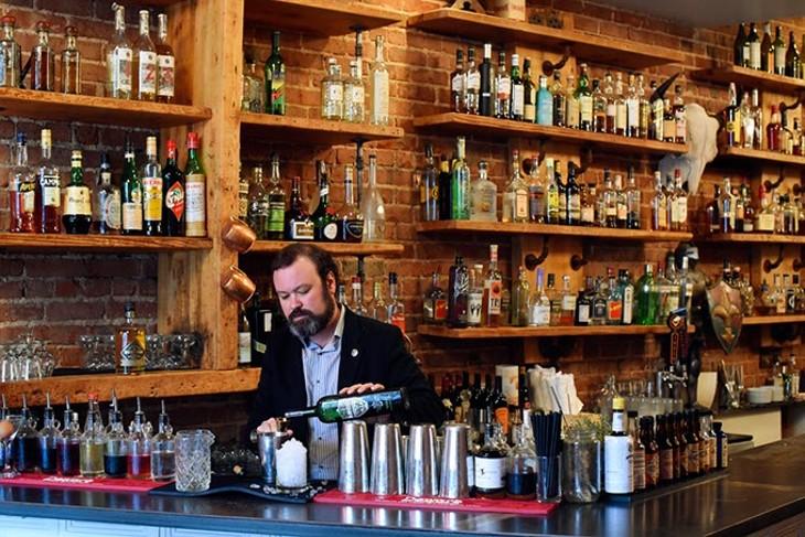 Chris Barrett makes a cocktail at Ludivine, Monday, April 11, 2016. - GARETT FISBECK