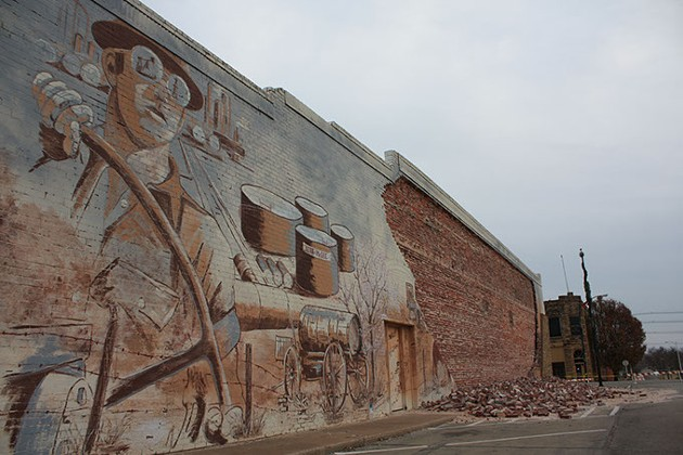 A wall of mural bricks fell from the Lions Club building in downtown Cushing following a 5.0 magnitude earthquake in November.   Photo Laura Eastes