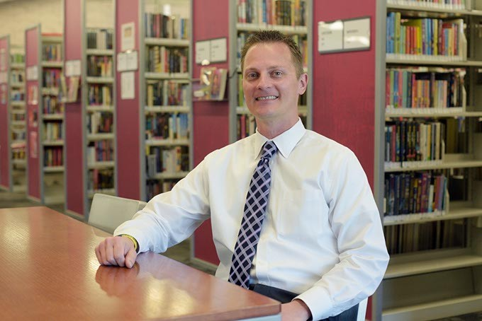 Ryan Schwikhart poses for a photo at Southern Oaks Library, Monday, April 10, 2017. - GARETT FISBECK