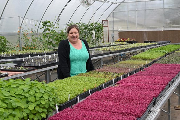 Julia Laughlin poses for a photo at Prairie Earth Gardens, Tuesday, April 4, 2017. - GARETT FISBECK