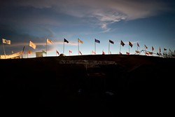 Flags representing North American indigenous tribes line a hilltop at North Dakota's Standing Rock Indian Reservation. (Wade Dunstan / for Oklahoma Gazette)