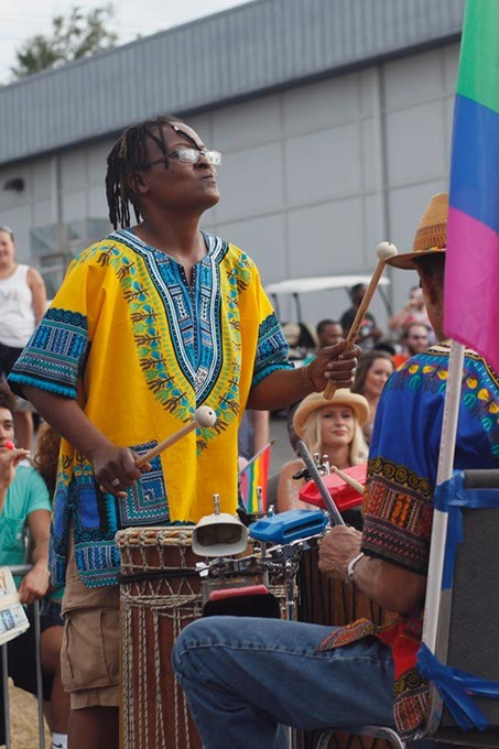 A participant in the parade plays a variety of percussion instruments on a float during Pride on Sunday, June 25, 2017. (Cara Johnson).