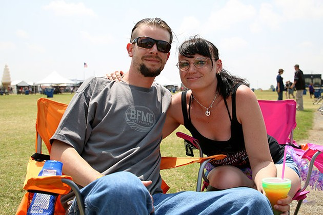 Justin Parker and his girlfriend Amanda Tracey sit in lawn chairs west of the main stage at Rocklahoma in Pryor, Okla. on Saturday, May 27, 2017. It was the couple's first year at Rocklahoma. (Cara Johnson).