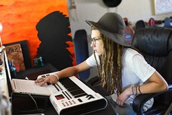 Local rapper and painter Chief Peace (aka Hippy Kid) at his home studio, Monday, July 18, 2016. - GARETT FISBECK