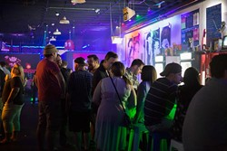 Crowd relaxes at the Flash Back Retro Pub 90's Night on Saturday, July 30, 2016 in Oklahoma City. - EMMY VERDIN