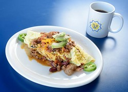 Omelet with bacon, avocado, jalapeno and cheddar covered in chili, at Sunnyside Diner, Tuesday, Jan. 17, 2017. - GARETT FISBECK