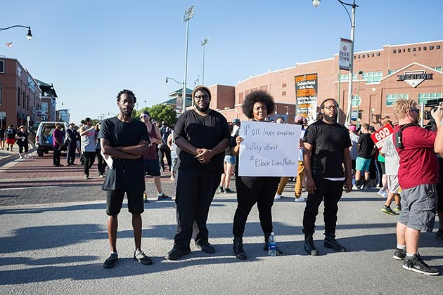 Quinonous Hardy, Derrick Hood, LaSandra Reed and Phillip Payne stand together at the Black Lives Matter protest on Sunday, July 10, 2016 in Oklahoma City. - EMMY VERDIN